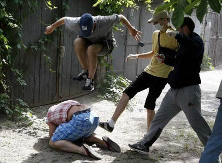 Thugs beat gay activist in Ukraine (Photo courtesy of Reuters)