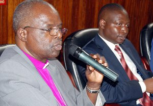 Archbishop Henry Orombi and member of parliament David Bahati (Photo courtesy of NewVision)