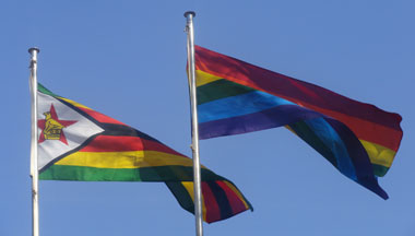 Zimbabwe and rainbow flag, side by side. (Photo courtesy of Miles R. Tanhira)