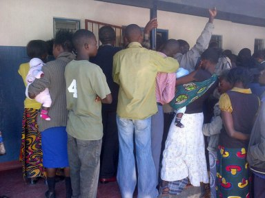 Members of the public gather outside the courtroom in Kapiri Mponshi, Zambia.