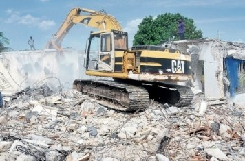 Demolition of abandoned house where homeless homosexual men were living. (Photo courtesy of Jamaica Observer)