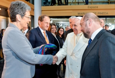 Austria's Ulrike Lunacek, openly lesbian member of the European Parliament, presents a rainbow-colored scarf to Pope Francis. (Photo courtesy of Christian Today)