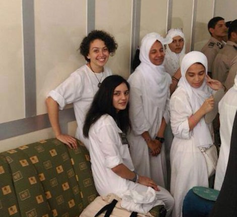 Yara Sallam (top L), Sanaa Seif (bottom L), and three other defendants in prison garb at a Sept. 13 hearing (Photo courtesy of Scott Long)