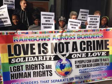 """Love Is Not A Crime,"" say demonstrators in London on Nov. 25, seeking repeal of anti-homosexuality laws. (Photo courtesy of Peter Tatchell Foundation)"