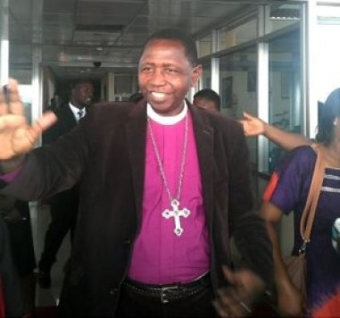 Archbishop Stanley Ntagali greets at Entebbe Airport on his return from England on Jan. 16. (Photo courtesy of the Church of Uganda)