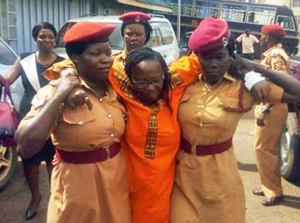Back in 2017, prison officers had to assist Stella Nyanzi before her appearance in court on the first set of charges she faced for insulting President Yoweri Museveni. She was suffering from malaria. (Betty Ndagire photo courtesy of the Daily Monitor)