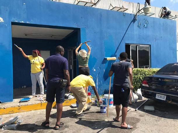 LGBT community members at Montego Bay Pride paint the Freeport Police Station. (Photo courtesy of Maurice Tomlinson)