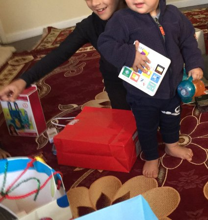 Afghan children in San Diego welcomed the visit from Baba Noel. (Photo courtesy of Linda Miles)