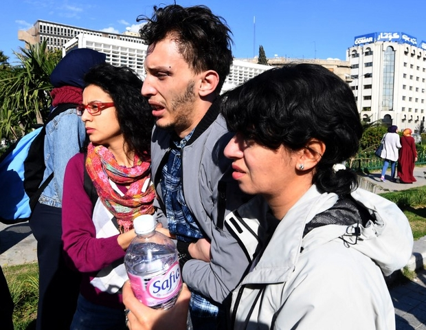 Tunisian LBGT activists help Bouhdid Belhedi (C), the director of Shams Radio, the first LGBT radio in the Arab region, after a scuffle with police who came to disperse the protest in Tunis on Jan. 27, 2018. (Fethi Belaid photo courtesy of AFP)
