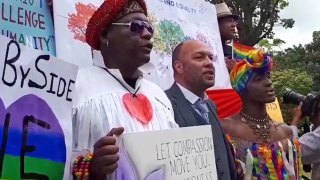 Supporters of LGBT rights demonstrate today outside Trinidad's Hall of Justice. Jason Jones, who suited to overturn Trinidad's anti-gay laws, is in the center.
