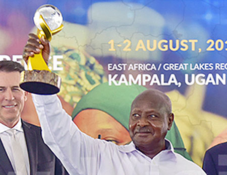Ugandan President Yoweri Museveni displays the peace prize trophy that he won. (Maria Wamala photo courtesy of New Vision)