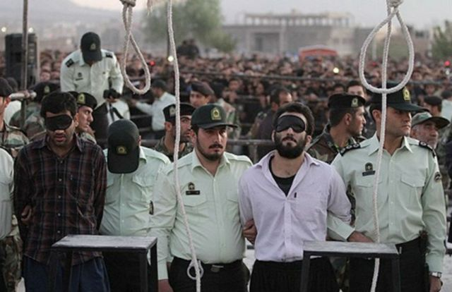 This photo, which shows a public hanging years ago in Iran, is often used to illustrate news articles about executions, such as the latest article about the January 2019 hanging of a convicted kidnapper, a 2017 article about eight people hanged on unspecified charges and commentaries in 2014 and 2016 about the pace of executions in Iran. (Photo courtesy of Wikicommons)