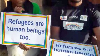 LGBT refugees protest in Nairobi, Kenya. At the right is Mbazira Moses, executive director of Rainbow Flag Kenya. (Photo courtesy of Facebook)