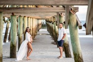 Beautiful maternity photos under the Myrtle Beach pier