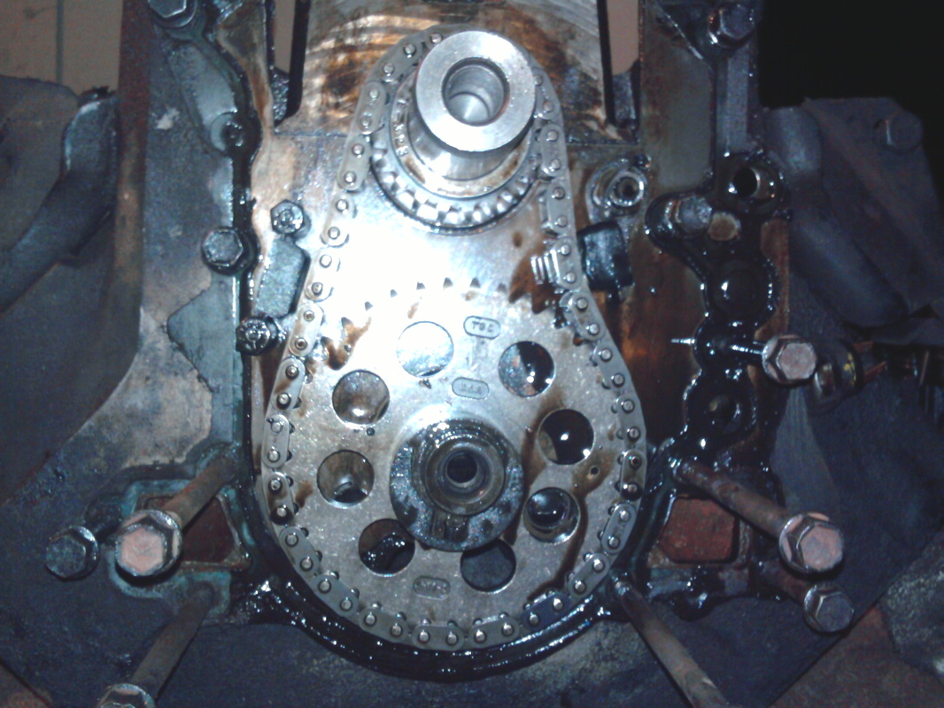 hight resolution of now you ve taken off the timing cover that exposes the timing chain and gears notice i m still putting the bolts back in the holes they came out of so i