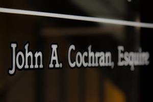 Interview John A Cochran, Esq. Image of the John A Cochran, Esquire sticker on his law office front door.