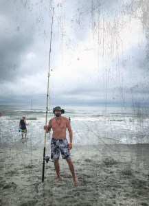 A Week Away. Photograph of Bobby Drakulic on the beach fishing in black and white swim trunks.