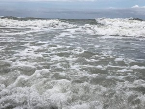 Image of the surf waves rippling in.