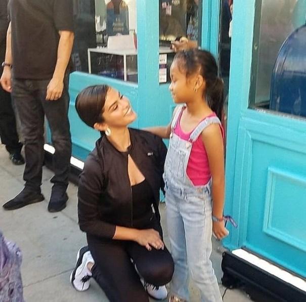 """May 16: Selena with a fan at the Puma """"Selena Gomez x Defy City ..."""