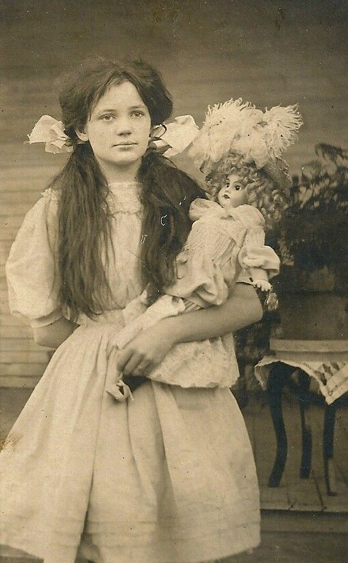 Edwardian Lady Holding A Cat With Dog At Her Feet