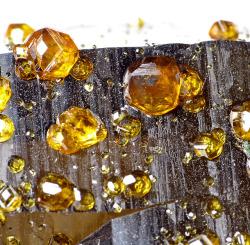 bijoux-et-mineraux:  Spessartine and Smoky Quartz - Tongbei, Yunxiao Co., Zhangzhou Perfecture, Fujian Province, China