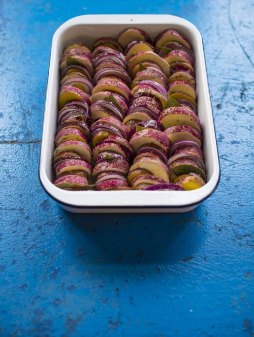 baked potatoes with red-skinned potatoes, sweet potatoes, red onions and bay leaf. yummy.