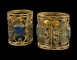 grandegyptianmuseum:   Two bracelets of Psusennes I Decorated with a winged scarab, holds the sun-disc in its front legs, and the shen-sign of infinity with its rear legs (gold, lapis-lazuli, carnelian and semi-precious stones), from the Tomb of Psusennes I at Tanis. Third Intermediate Period, 21st Dynasty, ca. 1069-945 BC. Now in the Egyptian Museum, Cairo.