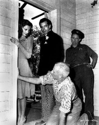 Howard Hawks on his knees filming Ball of Fire (1941) with Gary Cooper, Barbara Stanwyck and Allen Jenkins