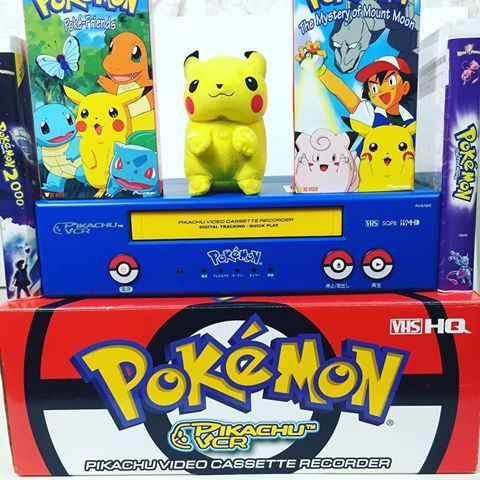 Pokemon VCR with a Pikachu plush as a remote