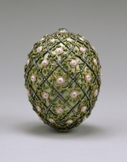 waltersartmuseum:Art of the Day: Rose Trellis Egg  On April 22, 1907, Tsar Nicholas II presented this egg to his wife, Alexandra Fedorovna, to commemorate the birth of the tsarevich, Alexei Nicholaievich, three years earlier. Because of the Russo-Japanese War in 1904, no Imperial Easter eggs had been produced for two years. The egg contained as a surprise a diamond necklace and an ivory miniature portrait of the tsarevich framed in diamonds (now lost). Fabergé's invoice, dated April 21, 1907, listed the egg at 8,300 rubles. Learn more about this object in our art site: http://bit.ly/2H0gzXR