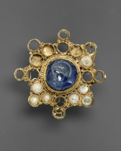 heaveninawildflower:Star-Shaped Brooch with Intaglio ( Ottonian, circa 950–1000, setting),Byzantine intaglio ( 337–50 ).Star sapphire, pearls, gold.Image and text information courtesy The Met.