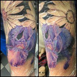 #iristattoo start of a half sleeve of flowers. #flowers #flowertattoo #colortattoo #tattoo #halfsleeve #tatsforgirls under plastic. @broadstreettattoo