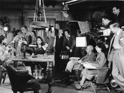 Howard Hawks in the director's chair on the set of His Girl Friday (1940) with Cary Grant, Rosalind Russell and Ralph Bellamy.