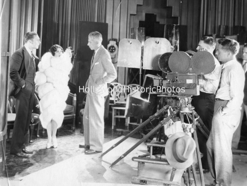 Howard Hawks on the set of Fig Leaves with George O'Brien and Olive Borden