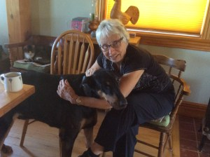 Picture of Ruth petting the Doberman Pinscher