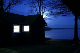 Lakeside cabin at night.