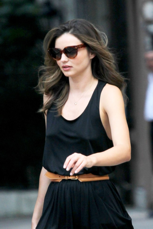 81122, NEW YORK, NEW YORK - Monday July 16, 2012. **EXCLUSIVE** Miranda Kerr changes into her own clothes and leaves the Victoria's Secret Fall/Winter photo shoot in New York City. The sexy supermodel goes braless in a black jumpsuit paired with a brown belt and brown stilettos. **FRANCE AND GERMANY OUT** Photograph: © Ralph, PacificCoastNews.com **FEE MUST BE AGREED PRIOR TO USAGE** **E-TABLET/IPAD & MOBILE PHONE APP PUBLISHING REQUIRES ADDITIONAL FEES** LOS ANGELES OFFICE: 1 310 822 0419 LONDON OFFICE: +44 208 090 4079