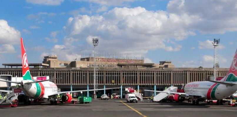 Nairobi, Kenya - August 24, 2008: Kenya Airways aircraft at the terminal building of Jomo Kenyatta International Airport