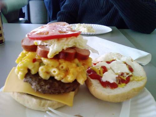 The Potluck Burger A burger with sliced hot dogs, potato salad, mac and cheese, tomato, ketchup, mustard and mayonnaise. (submitted by Jeeves)