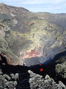 The lip of the volcano shows evidence of sulphur deposits