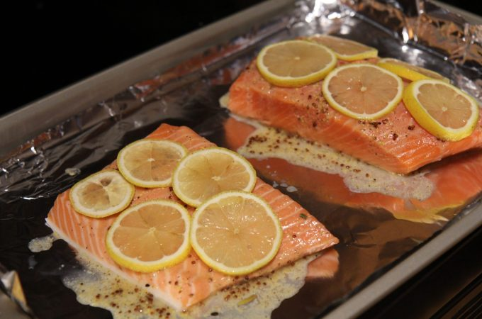 Baked lemon dijon salmon - delicious on the barbecue or in your oven - perfect every time! Paleo, keto, gluten-free, dairy-free, low carb, pescetarian - recipe by Christy Brissette media registered dietitian nutritionist at 80 Twenty Nutrition
