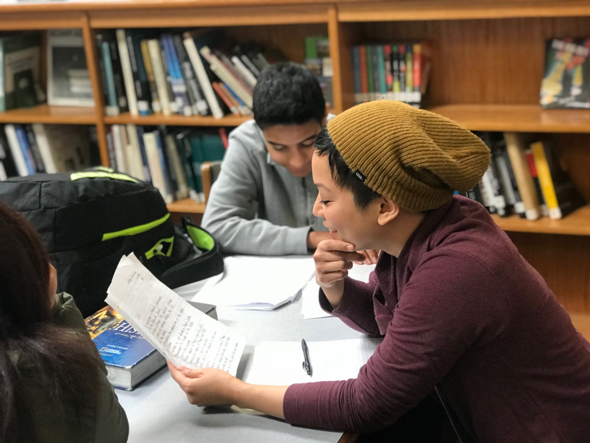 An 826DC volunteer supports a student with college essays