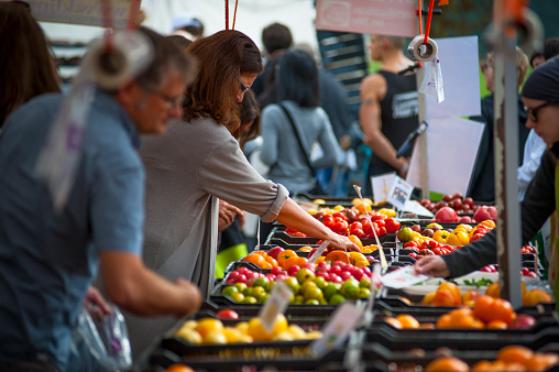 Vancouver, Сanada - September 8, 2013: People explore fresh produce and crafts at a local farmers market in Vancouver. This is the Kitsilano Farmers Market.