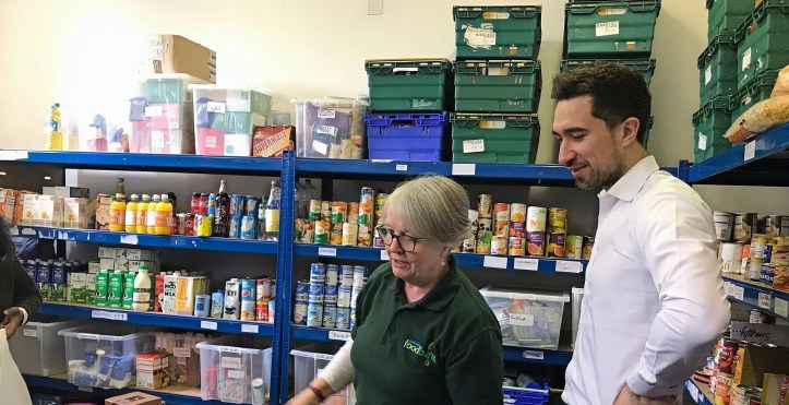 Damien Egan visiting the food bank