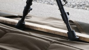 Loading the bipod against a wooden strip.