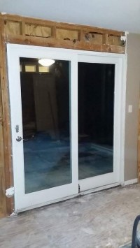 White wood framed, double pane sliding glass door in San