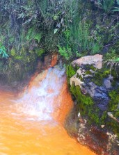 Orange thermal pools and waterfalls