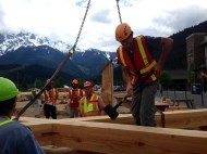 Jared helping the timber framers build the community barn