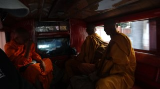 monks in the red car