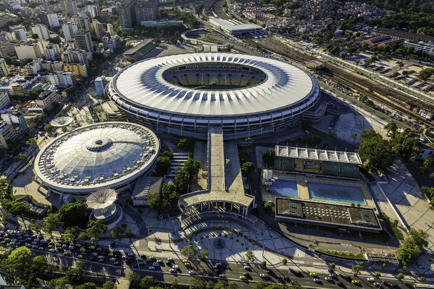 53206236 - rio de janeiro, brazil - february 2015: aerial photo of maracana stadium with panorama of rio de janeiro. opening and closing of 2016 olympic games will be held at maracana stadium.